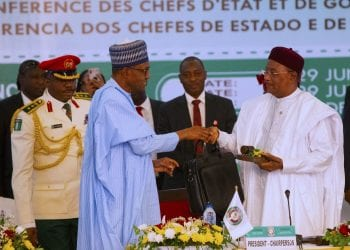 NEW ECOWAS CHAIRMAN 1A&B. President Muhammadu Buhari handover the Chairmanship to the President of Nigfer Republic H.E Mahamadou Issoufou during the closing ceremony of the 55th Session of the Authority of Heads of State and Governmment held at the State House Conference Center in Abuja. PHOTO; SUNDAY AGHAEZE. JUNE 29 2019