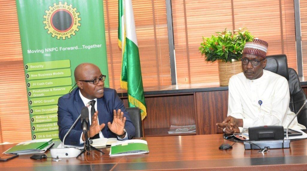 Executive Secretary of the Nigerian Extractive Industries Transparency Initiative (NEITI), Mr. Waziri Adio, briefing the NNPC GMD, Mallam Mele Kyari, on areas of cooperation between both organizations to enhance transparency