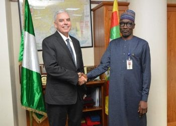 Group Managing Director of the Nigerian National Petroleum Corporation (NNPC) Mallam Mele Kyari with Chairman and Managing Director, ExxonMobil Companies in Nigeria, Mr. Paul McGrath during a meeting at NNPC Towers, Abuja
