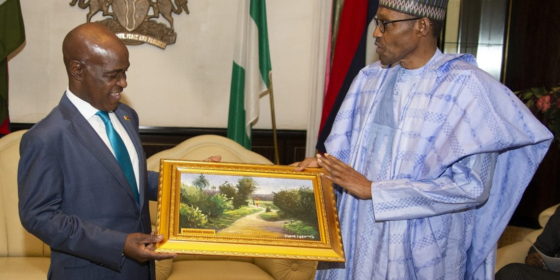 PRESIDENT BUHARI RECEIVES THE OUTGOING ZIMBABWE AMB MAZEMO 3. President Muhammadu Buhari present a gift to the outgoing Zimbabwe Ambassador to Nigeria, Mr Lovemore Mazemo during a farewell at the State House Abuja. PHOTO; SUNDAY AGHAEZE. AUGUST 1 2019