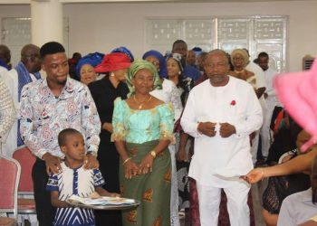 Left to right- Dr obinna Nwachukwu, the celebrant, his wife Lady Felicia with their family and friends at the memorial service at St James Anglican church Asokoro on Sunday
