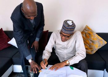President Buhari assents to the Bill amending the Deep Offshore (and Inland Basin Production Sharing Contract) Act, recently passed into law by the National Assembly.. With him is the Chief of Staff Abba Kyari